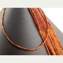 Garnet strand - faceted spheres 3 mm amber orange, length...
