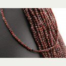 Garnet strand - faceted spheres 3 mm red, length 38.5 cm...