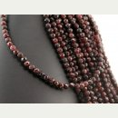 Garnet strand - faceted spheres 5 mm dark red, length 39...